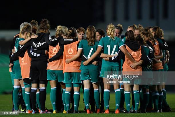 Women's Germany head coach Maren Meinert talks with their players at the end of the Four Nations Tournament match between U20 Women's France and U20...