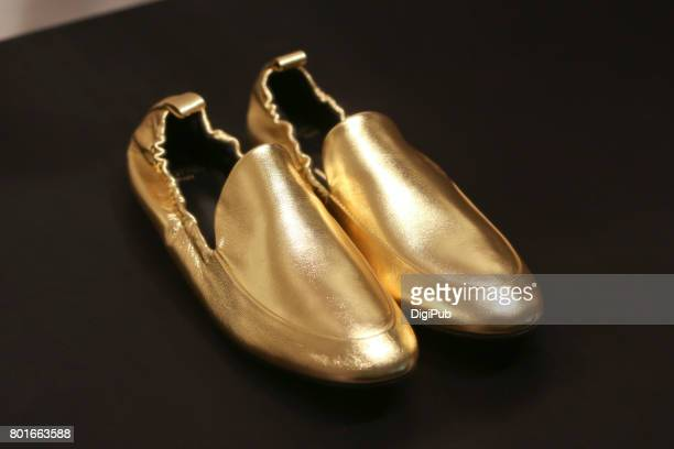 women's gold color leather shoes - gold shoe stock photos and pictures