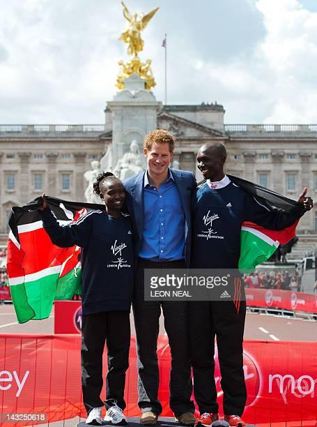 Women's Gold medal winner Mary Keitany of Kenya Britain's Prince Harry and Men's Gold medal winner Wilson Kipsang of Kenya pose in front of...