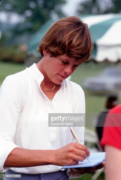 Women's golfer Jo Ann Washam signs an autograph during tournament play circa 1980 Washam was on the LPGA Tour from 197389