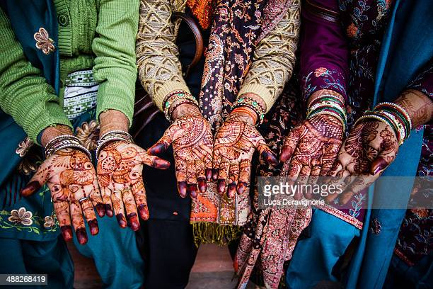 Women's hands painted with henna