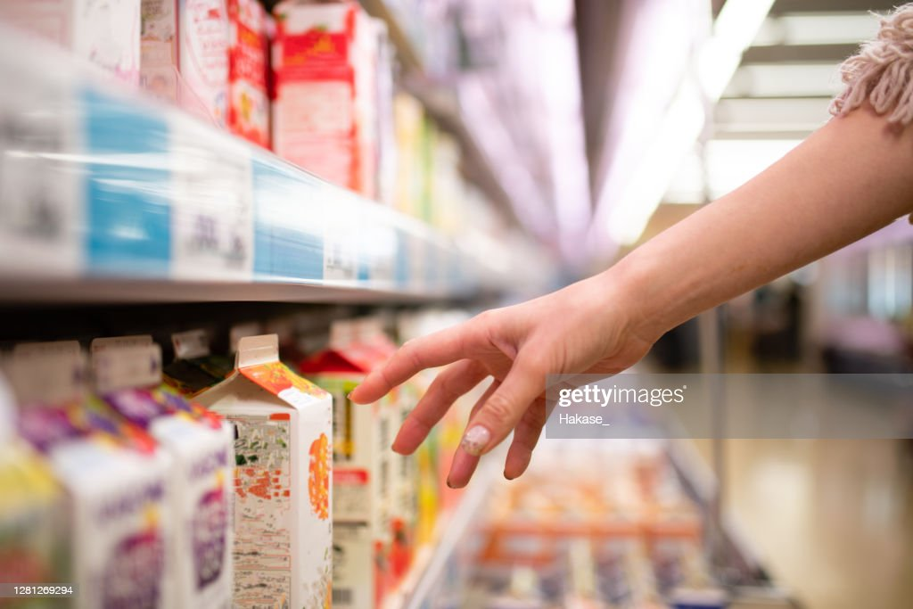 Women's hands shopping in a supermarket : Stock Photo