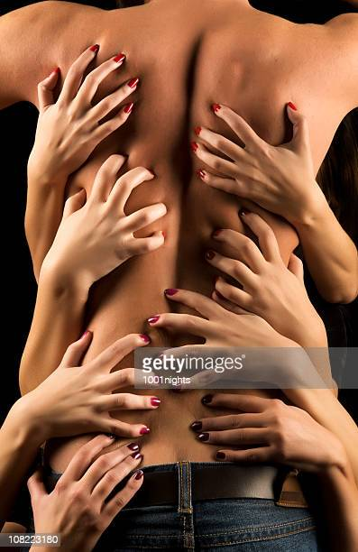 Women's Hands Suggestively Holding Shirtless Man's Back