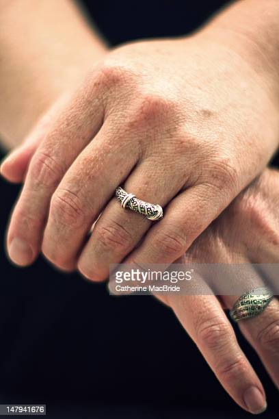 Women's hands with silver ring