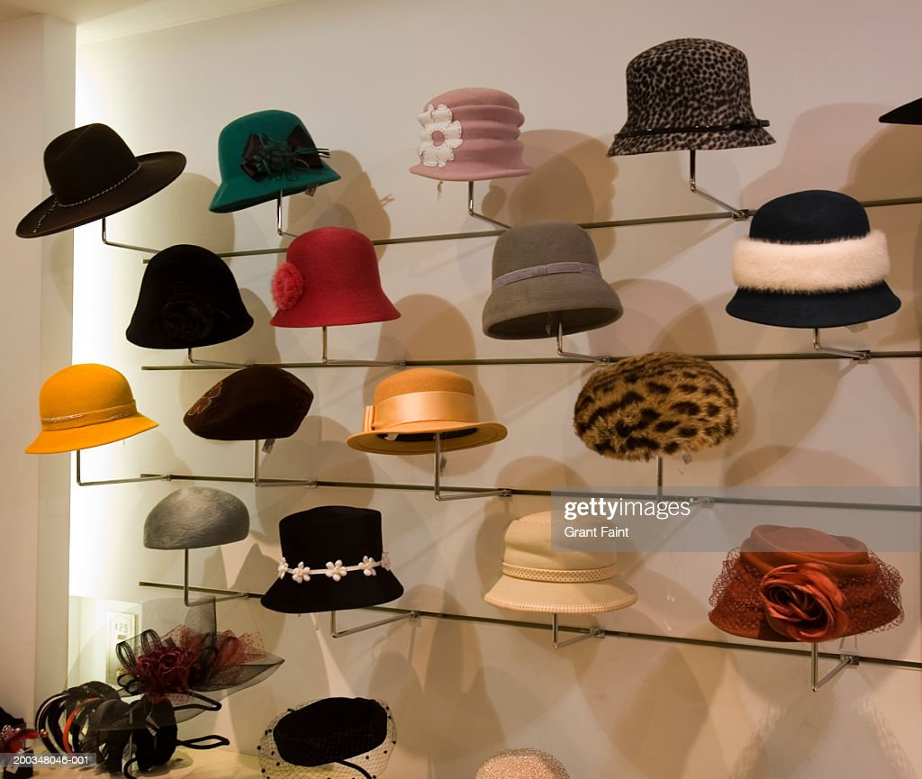 Women's hats on display in shop : Stock Photo