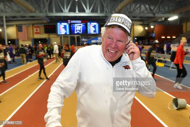 Women's Head Coach Lance Carter of the Arkansas Razorbacks celebrates after winning the team national title during the Division I Men'u2019s and...