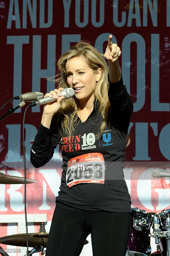 Women's Health publisher, Laura Frerer-Schmidt speaks onstage during Women's Health Magazine RUN10 FEED10 NYC 10K Race Event at Pier 84 on September 22, 2013 in New York City.