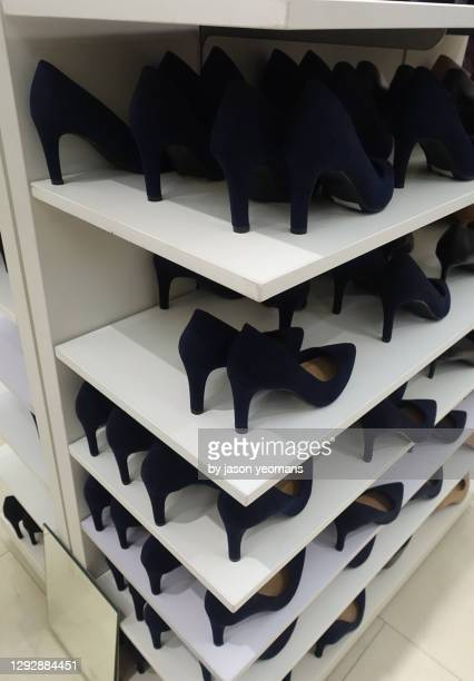 womens high heels in a shop - womenswear stock pictures, royalty-free photos & images
