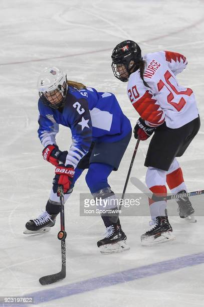 US Women's Hockey defender Lee Stecklein from Roseville MN and Canada Women's Hockey forward Sarah Nurse chase a loose puck during the women's gold...