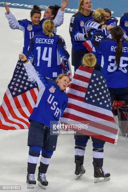 US Women's Hockey forward Kendall Coyne from Palos Heights IL is flag draped as she skates around her teammates following the women's gold medal...