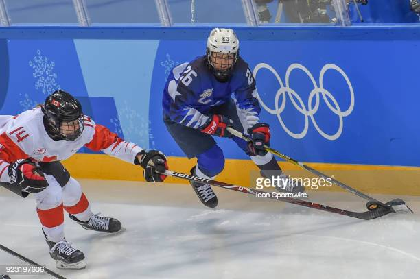 US Women's Hockey forward Kendall Coyne from Palos Heights IL looks to pass as Canada Women's Hockey defender Renata Fast defends during the women's...