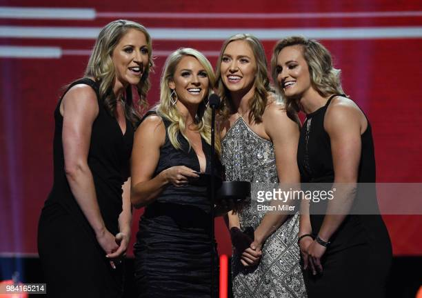 USA women's hockey players Meghan Duggan and Amanda Kessel and Canadian women's hockey players Brianne Jenner and MariePhilip Poulin present the Lady...