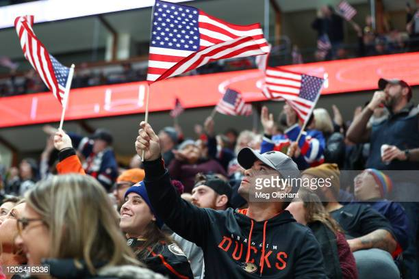 Women's Hockey Team fans wave American flags during the game against the Canadian Women's National Team at Honda Center on February 08, 2020 in...