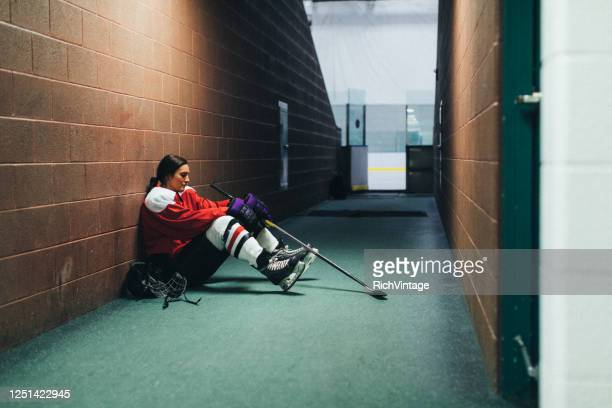 women's ice hockey player portrait - ice hockey player stock pictures, royalty-free photos & images