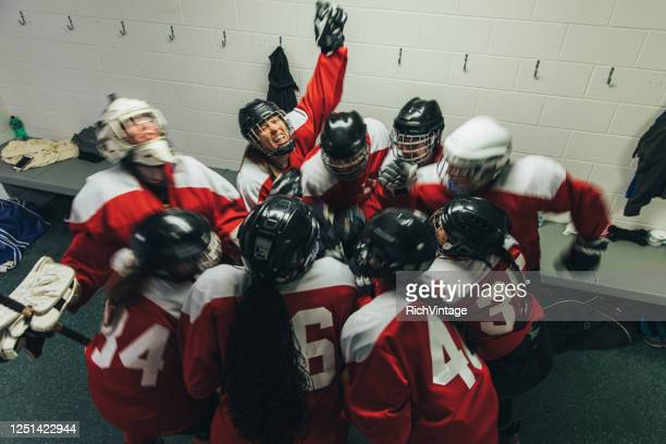 women's ice hockey team celebrates - ice hockey player stock pictures, royalty-free photos & images