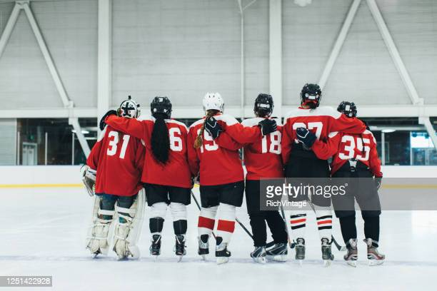 women's ice hockey team portrait - ice hockey player stock pictures, royalty-free photos & images