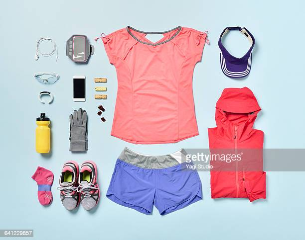 women's jogging supplies shot knolling style. - sportkleidung stock-fotos und bilder