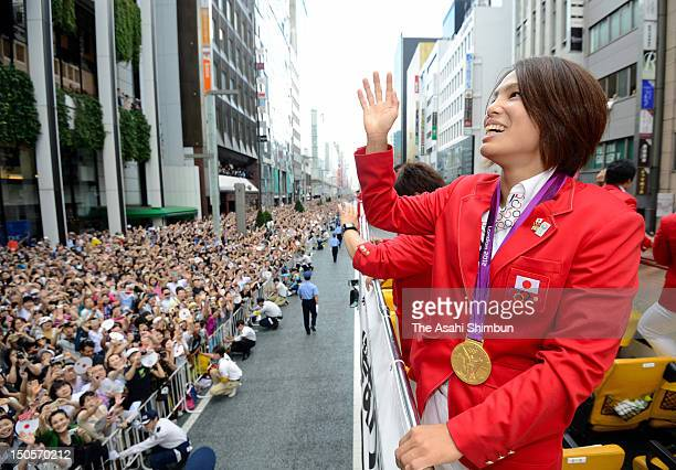 Women's Judo 57kg gold medalist Kaori Matsumoto waves to the crowds from an opentop bus during Japanfs Olympic medalists parade in streets of...