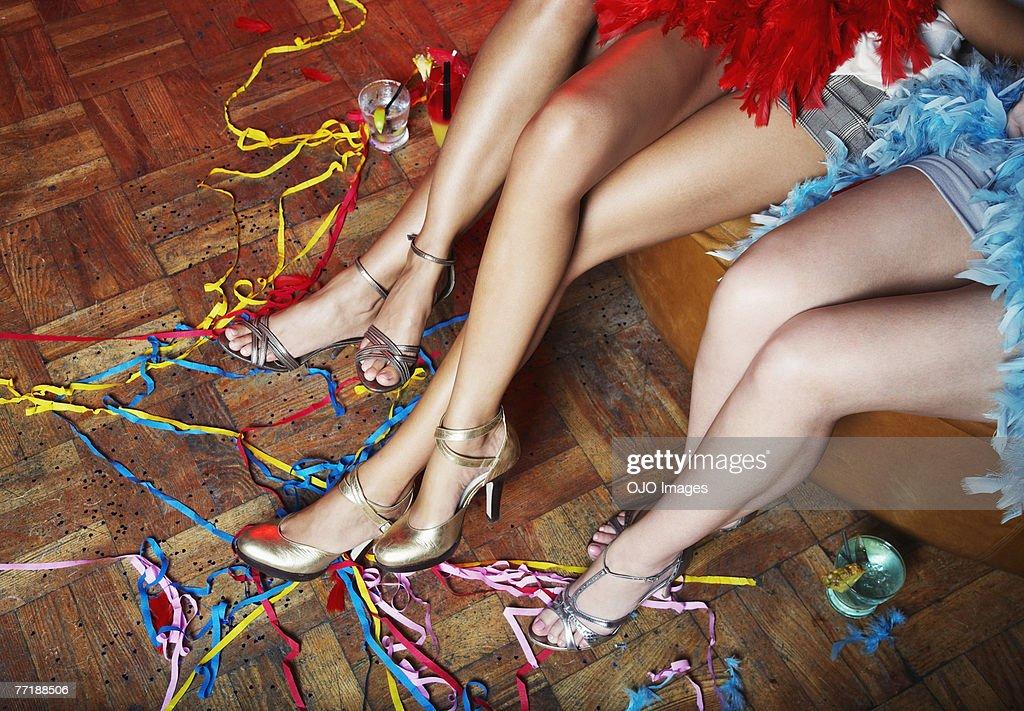 Women's legs at a club : Stock Photo