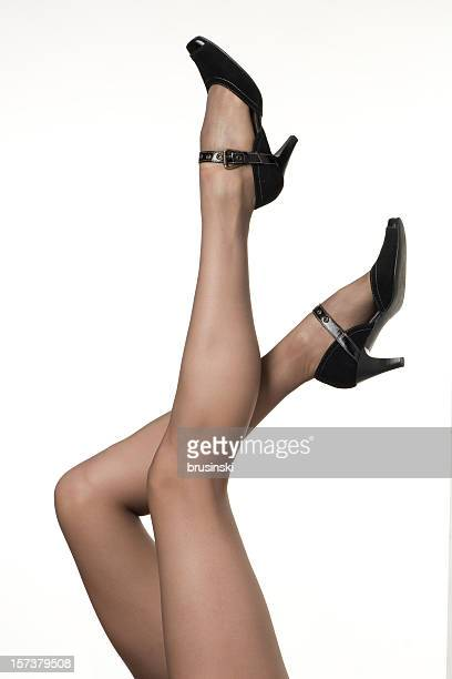 women's legs - women in stockings and high heels stock photos and pictures