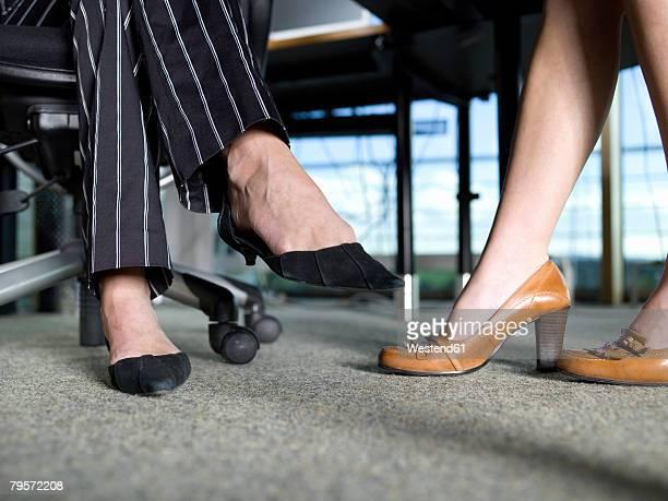 Women?s legs under desk