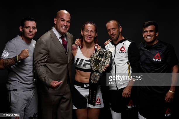 UFC women's lightweight champion Cris Cyborg of Brazil poses for a post fight portrait backstage during the UFC 214 event inside the Honda Center on...