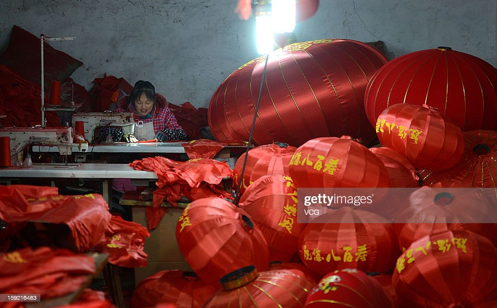 A womens makes red lanterns as the Chinese Lunar New Year is approaching on January 9, 2013 in Chengdu, Sichuan Province of China. Fall on February 10 this year, the Chinese Lunar New Year, also known as the Spring Festival, which is based on the Lunisolar Chinese calendar, will be celebrated from the first day of the first month of the lunar year and ends with Lantern Festival on the Fifteenth day.
