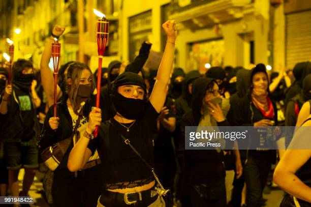 SPAIN PAMPLONA NAVARRA SPAIN Womens manifestation radical activists called The Farrukas carry candles with their faces covered during the protest...