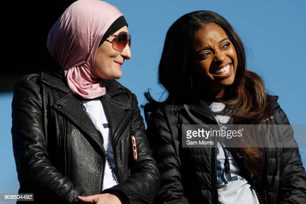 Women's March cochariwomen Linda Sarsour and Tamika Mallory smile while listening to a speaker during the Women's March Power to the Polls voter...