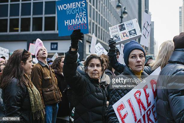 Womens March in New York Holding Signs