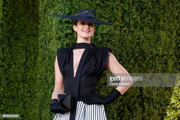 Women's Myer Fashions on the Field daily winner Montelle Mondello poses at The Park on AAMI Victoria Derby Day at Flemington Racecourse on November 4...
