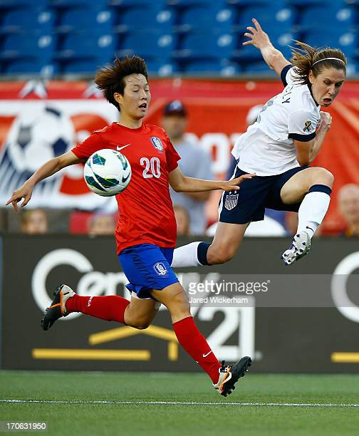 Womens National midfielder Heather O'Reilly crosses the ball in front of Korea Republic defender Kim Hyeri in the first half during the game at...