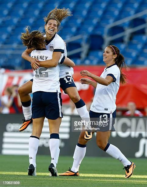 Womens National midfielder Tobin Heath jumps into the arms of teammate US Womens National midfielder Lauren Cheney following Cheny's goal in the...