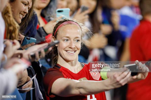 S Women's National Soccer Defender Becky Sauerbrunn takes selfie pictures with fans after the international friendly soccer match between the United...