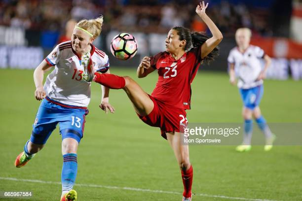 S Women's National Soccer Forward Christen Press kicks Russia's defender Anna Belomyttseva while playing a loose ball during the international...