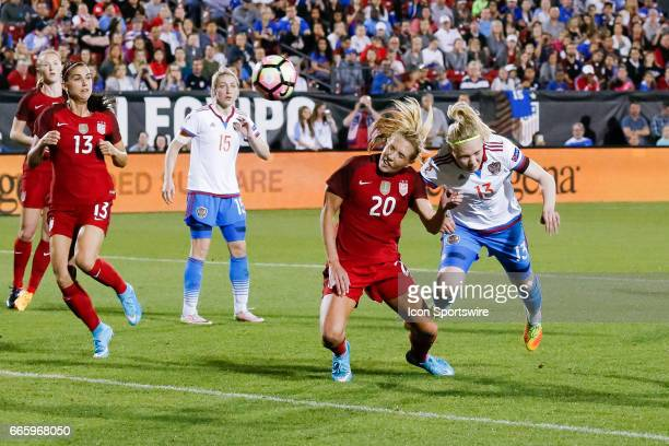 S Women's National Soccer Midfielder Allie Long scores on a header during the international friendly soccer match between the United States Women's...
