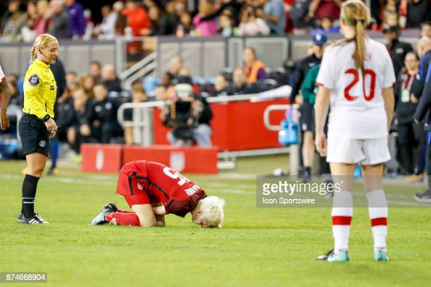 Women's National Team Forward Megan Rapinoe lays on the ground with an injury during the friendly soccer match between the US Women's National Team...