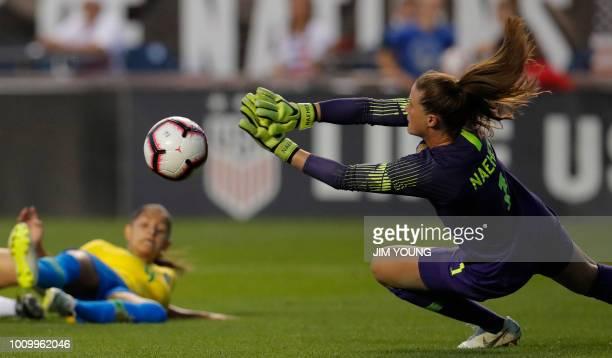 US Women's National Team goalkeeper Alyssa Naeher makes a save off Brazil's forward Debinha during the Tournament of Nations women's football match...