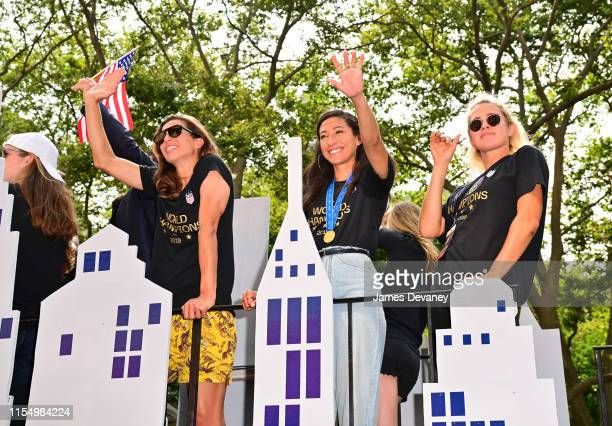 S Women's National Team members Tobin Heath Christen Press and Abby Dahlkemper celebrate their 2019 FIFA World Cup win at Ticker Tape Parade in...