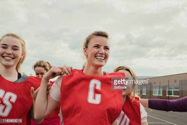 women's netball team celebrating a win! - team sport stock pictures, royalty-free photos & images