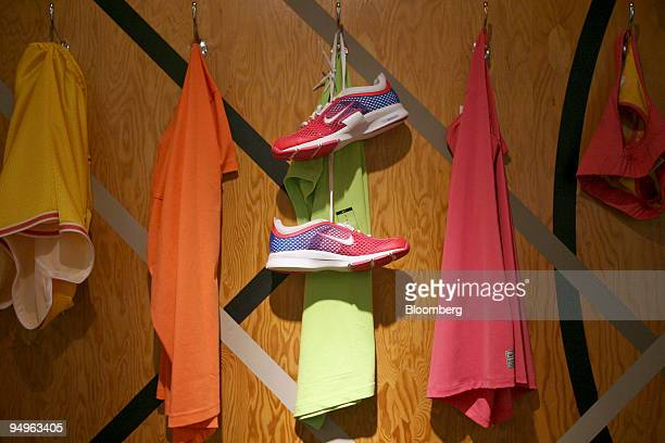 Women's Nike sneakers and running apparel sit on display at the Niketown store in New York US on Wednesday June 24 2009 Nike Inc the world's largest...