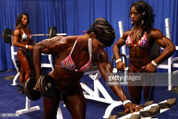 Women's Physique International contestants warm up in the pump up room backstage at the Greater Columbus Convention Center during the Arnold Sports...