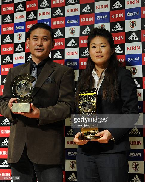 FIFA Women's Player of the Year Homare Sawa and FIFA World Coach of the Year for Women's Football Norio Sasaki pose for photographs with their...