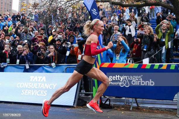Women's professional division runner Shalane Flanagan runs towards the finish line in Central Park to win the 2017 TCS New York City Marathon on...