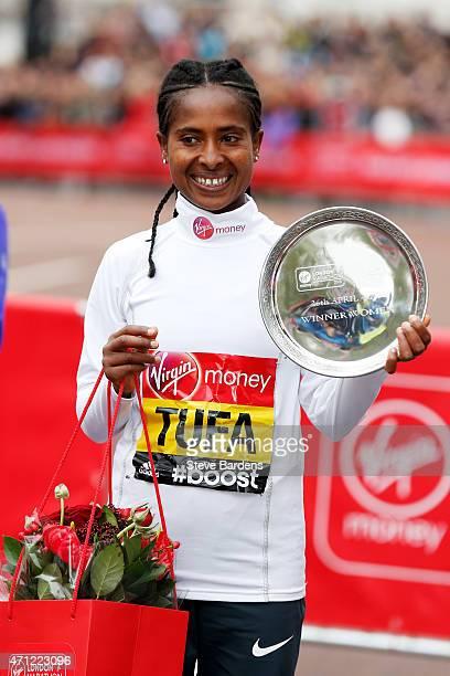 Women's race winner Tigist Tufa of Ethiopia celebrates with trophy following the Virgin Money London Marathon on April 26, 2015 in London, England.