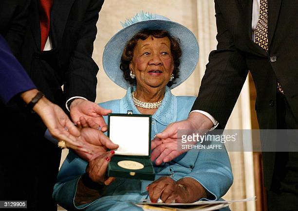 Women's rights champion and civil rights leader Dr Dorothy Height is presented with the Congressional Gold Medal during a ceremony in the Rotunda at...