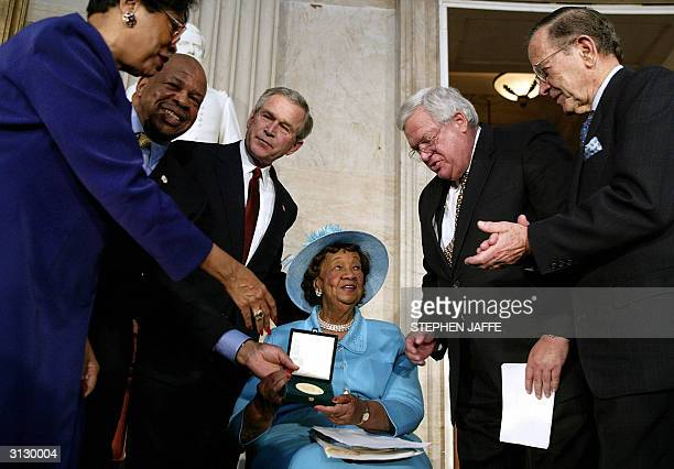 Women's rights champion and civil rights leader Dr Dorothy Height is presented with the Congressional Gold Medal during a ceremony in the Rotunda of...