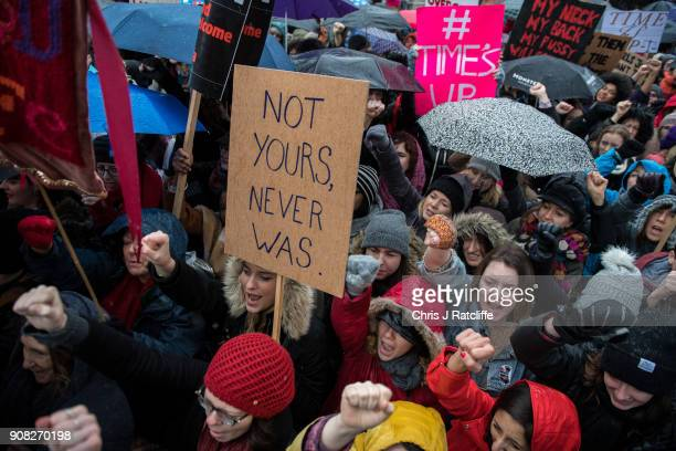 Women's rights demonstrators hold placards and chant slogans during the Time's Up rally at Richmond Terrace opposite Downing Street on January 21...