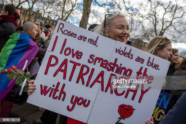 Women's rights demonstrators hold placards during a rally in Russell Square on International Women's Day on March 8 2018 in London England...