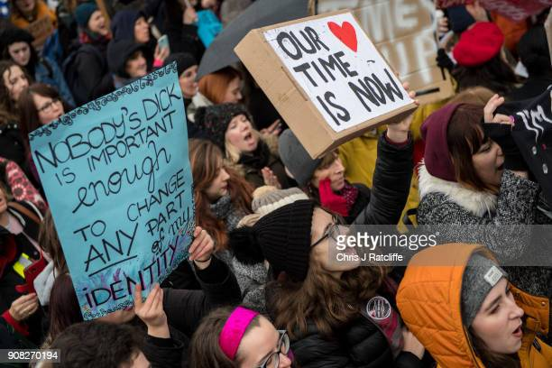 Women's rights demonstrators hold placards during the Time's Up rally at Richmond Terrace opposite Downing Street on January 21 2018 in London...